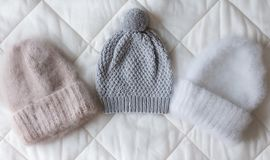Fluffy hats of various styles and colors hand-knitted. From wool on the spokes Stock Images