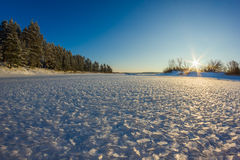 Fluffy ice on the river Mologa in the winter. Evening walk on the ice of the river Mologa Royalty Free Stock Image