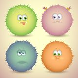 Fluffy monsters. Set of cute cartoon fluffy creature with different emotions and colors, for games. Vector illustration Royalty Free Stock Photography