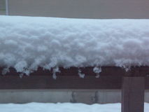 Fluffy New Snow on House Eaves Stock Image