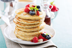 Fluffy oatmeal pancakes stack with fresh berries Royalty Free Stock Photography