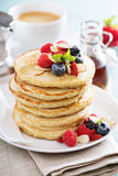 Fluffy oatmeal pancakes stack with fresh berries Royalty Free Stock Image
