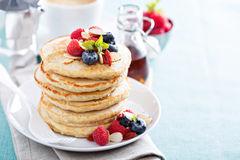 Fluffy oatmeal pancakes stack with fresh berries Stock Photography