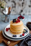 Homemade pancake with raspberry, blueberry, currant and black berry for breakfast. royalty free stock photos