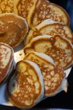 Fluffy pancakes on a plate royalty free stock photos
