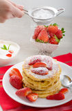 Fluffy pancakes with strawberries Stock Images