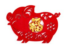 Paper-cut on white as symbol of Chinese New Year of the pig the Chinese means good luck. Fluffy paper-cut on white as symbol of Chinese New Year of the pig the stock image