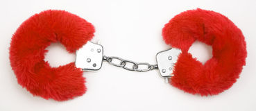 Fluffy pink handcuffs Royalty Free Stock Image