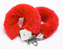Fluffy pink handcuffs Stock Images
