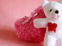 Fluffy pink heart and happy white teddy bear for love. And valentine on pink background Stock Photo