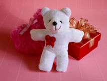 Fluffy pink heart and happy white teddy bear and red gift for love Stock Photography