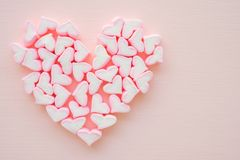 Fluffy pink heart marshmallow heart shape on pink background fro. M top view stock images
