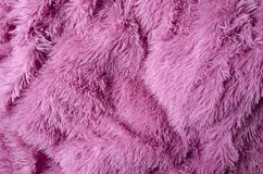 Fluffy pink modern plaid as a background royalty free stock photography