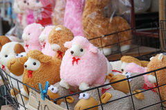 Fluffy pink sheep dolls. In market royalty free stock images