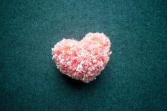 Fluffy pink thread heart on gray felt background. Handmade prett Royalty Free Stock Photography