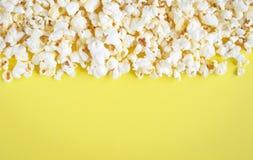 Fluffy popcorn on yellow Royalty Free Stock Photos