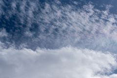 White fluffy clouds. Fluffy puffy clouds background with sun shine royalty free stock image
