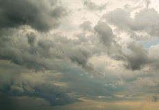 Fluffy Rain Clouds Against Cloud Filled Sky Stock Photos