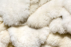 Fluffy sheep skin background. Sheep skins stacked in a pile offered for sale on the market in Zakopane Royalty Free Stock Image