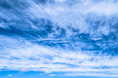 Fluffy small cirrostratus , cirrocumulus and cirrus cloud formations blue sky. Stock Photography