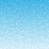 Fluffy snow. On a blue background Royalty Free Stock Image