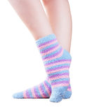 Fluffy striped socks. Woman legs in fluffy colorful striped socks ovwe white background Royalty Free Stock Photos