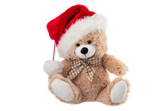 Fluffy teddy bear with Christmas hat isolated on white Royalty Free Stock Image