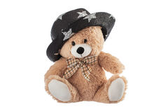 Fluffy teddy bear with party hat isolated on a white Royalty Free Stock Images