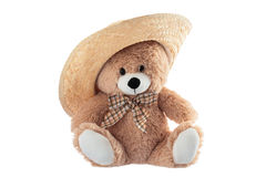 Fluffy teddy bear with straw hat hat isolated on a white backgro Royalty Free Stock Photo