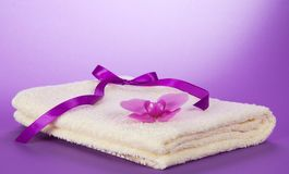 The fluffy, terry towel and orchid Royalty Free Stock Photography