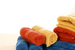 Fluffy Towels. Colorful fluffy towel and wash clothes arranged decoratively Stock Images
