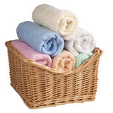Fluffy towels in a basket. Fluffy towels in a basket, isolated on white background Stock Photos
