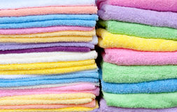 Fluffy towels in many colors Stock Photos