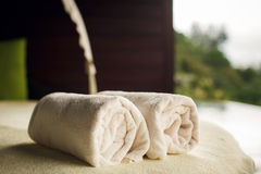Fluffy towels and seashells on beach table Stock Image