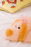 Fluffy toy. Children's toy - fluffy dog with pink ribbon Stock Photo