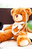 Fluffy toy bear with pearls Stock Image
