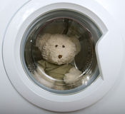 Fluffy toy in washing machine Royalty Free Stock Images