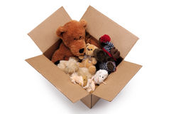 Fluffy toys in a box. Fluffy toys in a cardboard box Royalty Free Stock Photos
