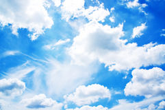 Fluffy white cloud. Over blue background Stock Photos