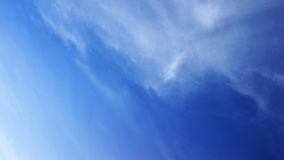 Fluffy white cloud and blue sky Stock Image