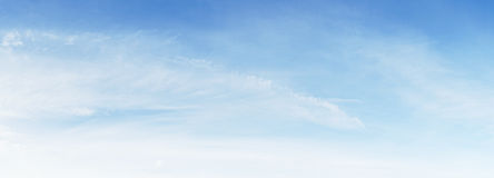 Fluffy white cloud and bright blue sky Stock Image