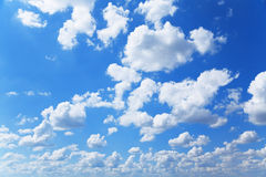 Fluffy white clouds Stock Images
