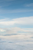Fluffy white clouds and blue sky background Stock Photography