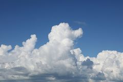 Clouds in sky. Fluffy white clouds in a blue sky Stock Photos