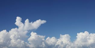 Clouds in sky. Fluffy white clouds in a blue sky Royalty Free Stock Images