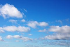 Clouds in sky. Fluffy white clouds in a blue sky Royalty Free Stock Photos