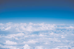 Fluffy white clouds and blue sky with copy space, airplane view Stock Photo