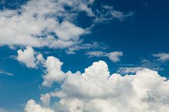 Fluffy white clouds on blue sky horizon. Cumulus landscape background.  royalty free stock photos