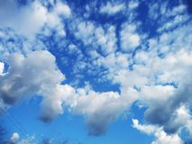 Fluffy white clouds in the blue sky stock photography