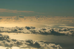 Fluffy white clouds on blue sky over idyllic sea. Fluffy white clouds on blue sky, celestial dome, over idyllic sea or ocean water surface background. Overcast Stock Images